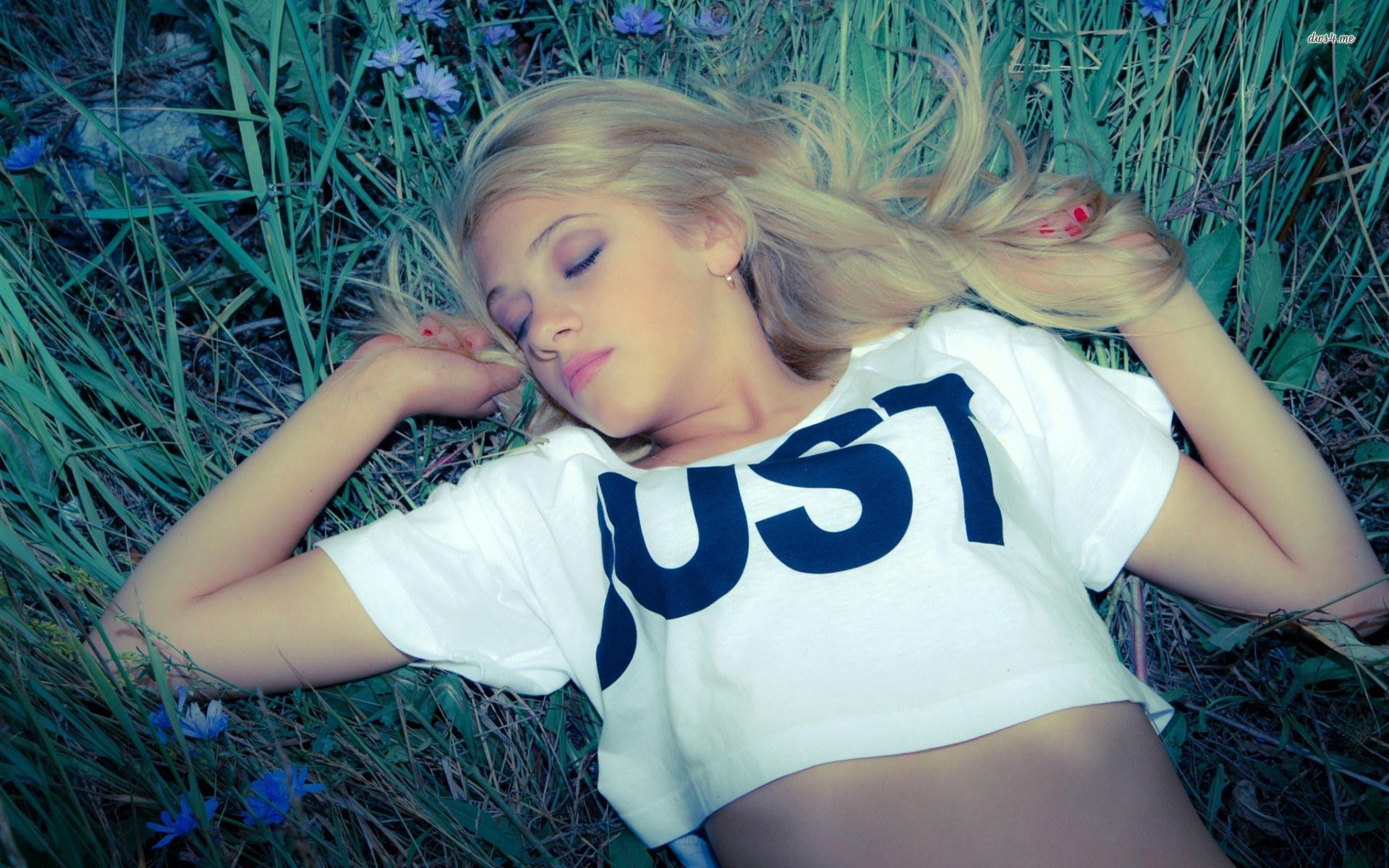 Beautiful woman laying in the grass
