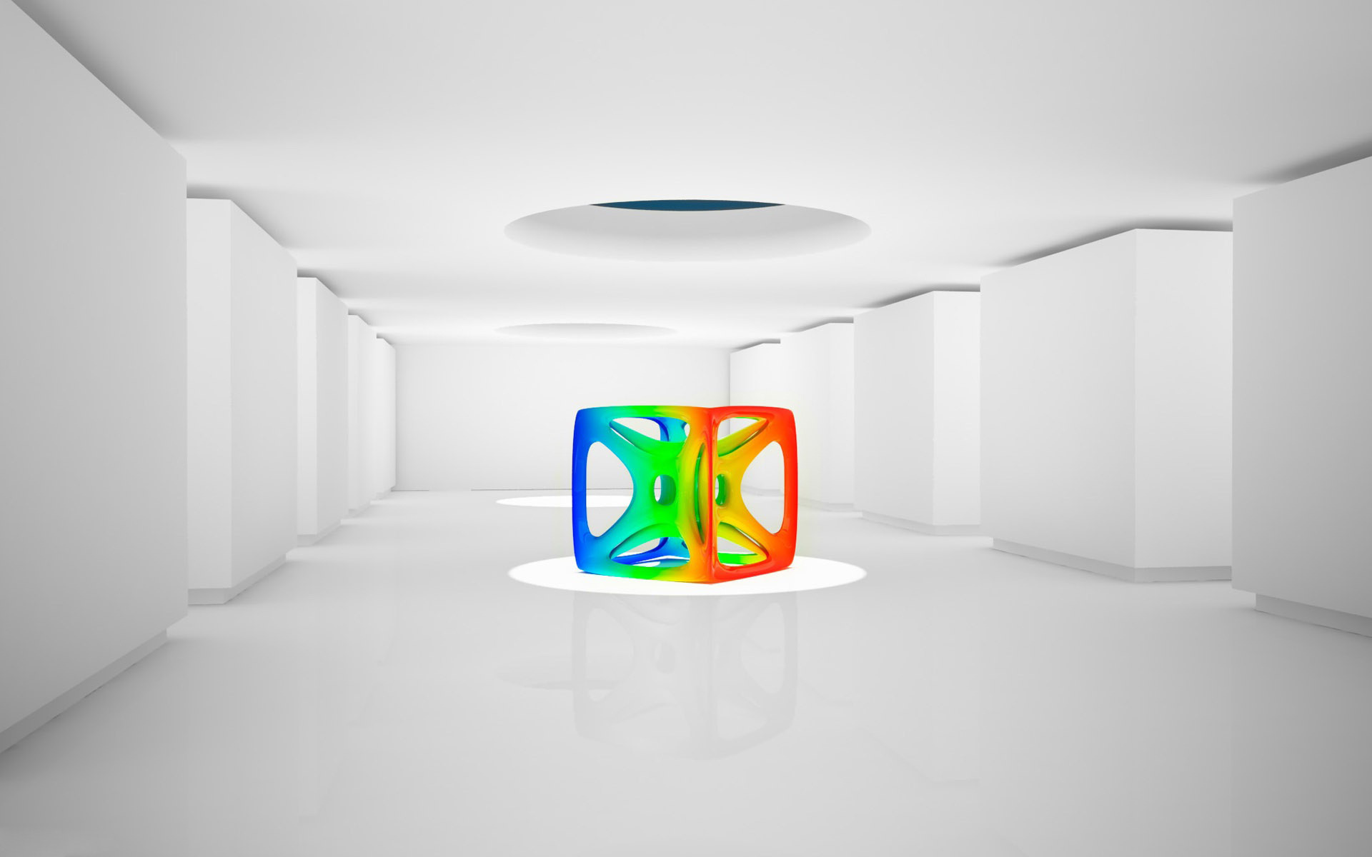 Colorful cube in the middle of white room