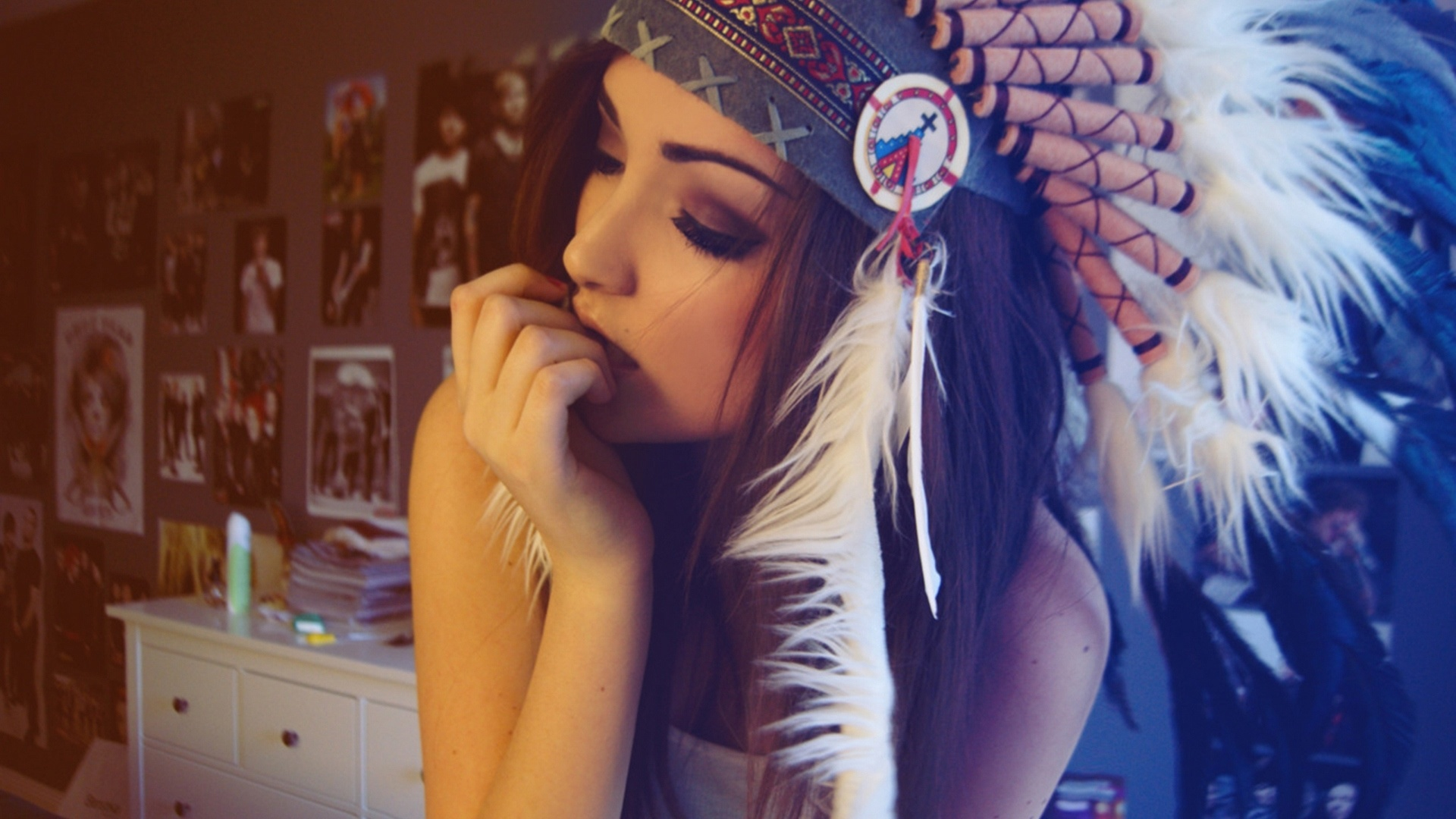 Girl wearing red indian colorful feathers hat