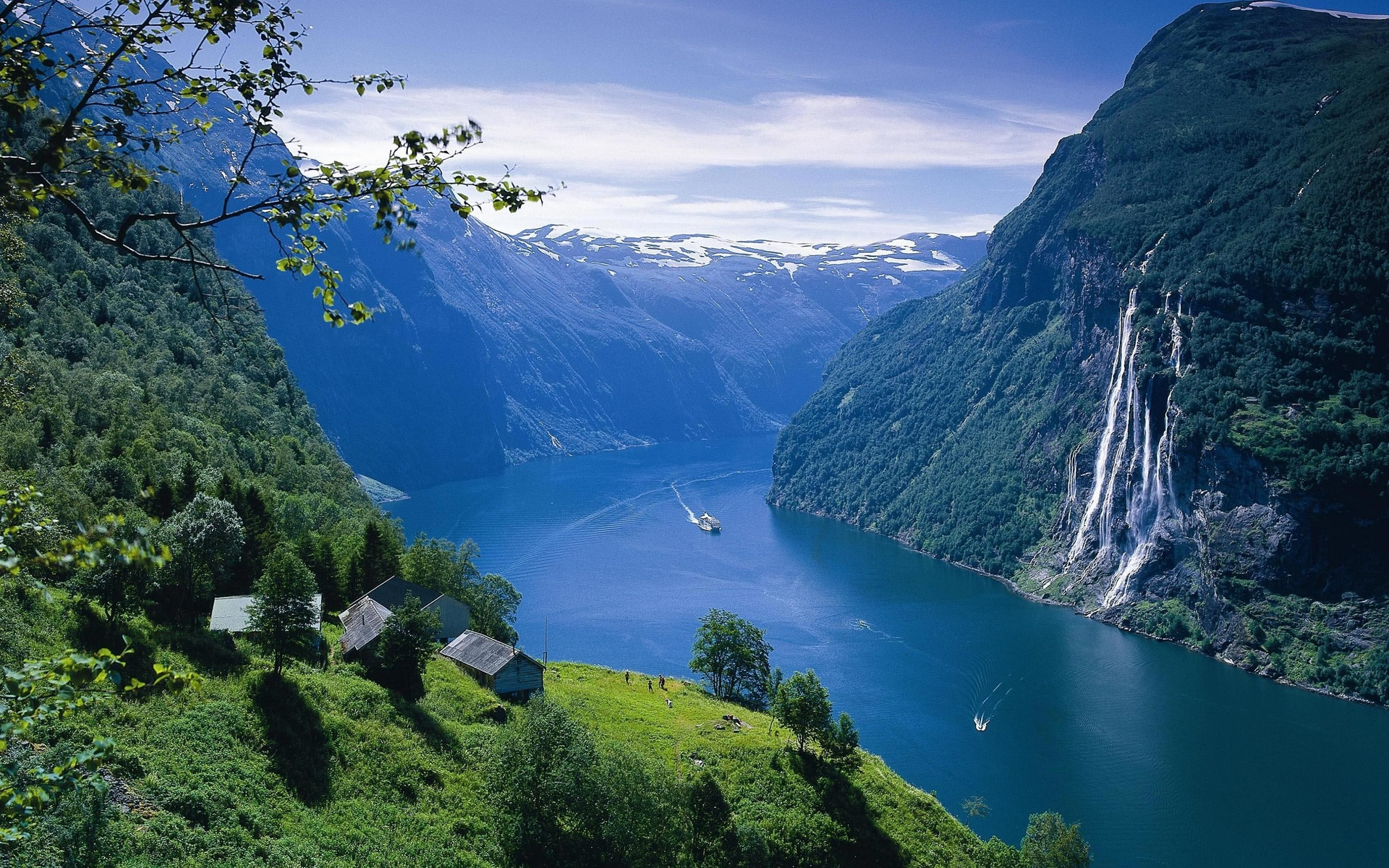 landscape fjord Norway water sea ocean buildings architecture houses mountains waterfall sky clouds trees