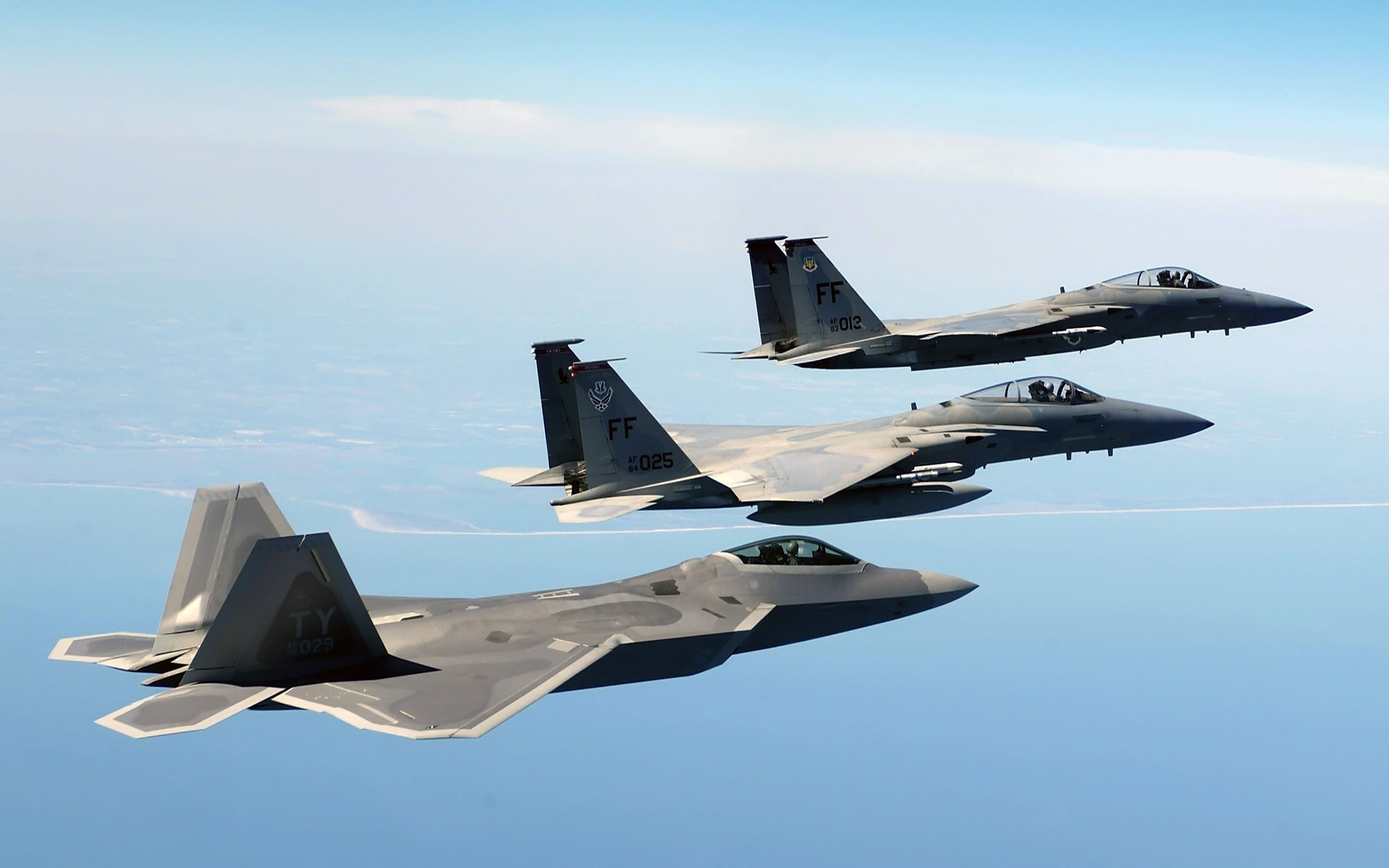 Lockheed Martin F-22 Raptor and McDonnell Douglas F-15 Eagle