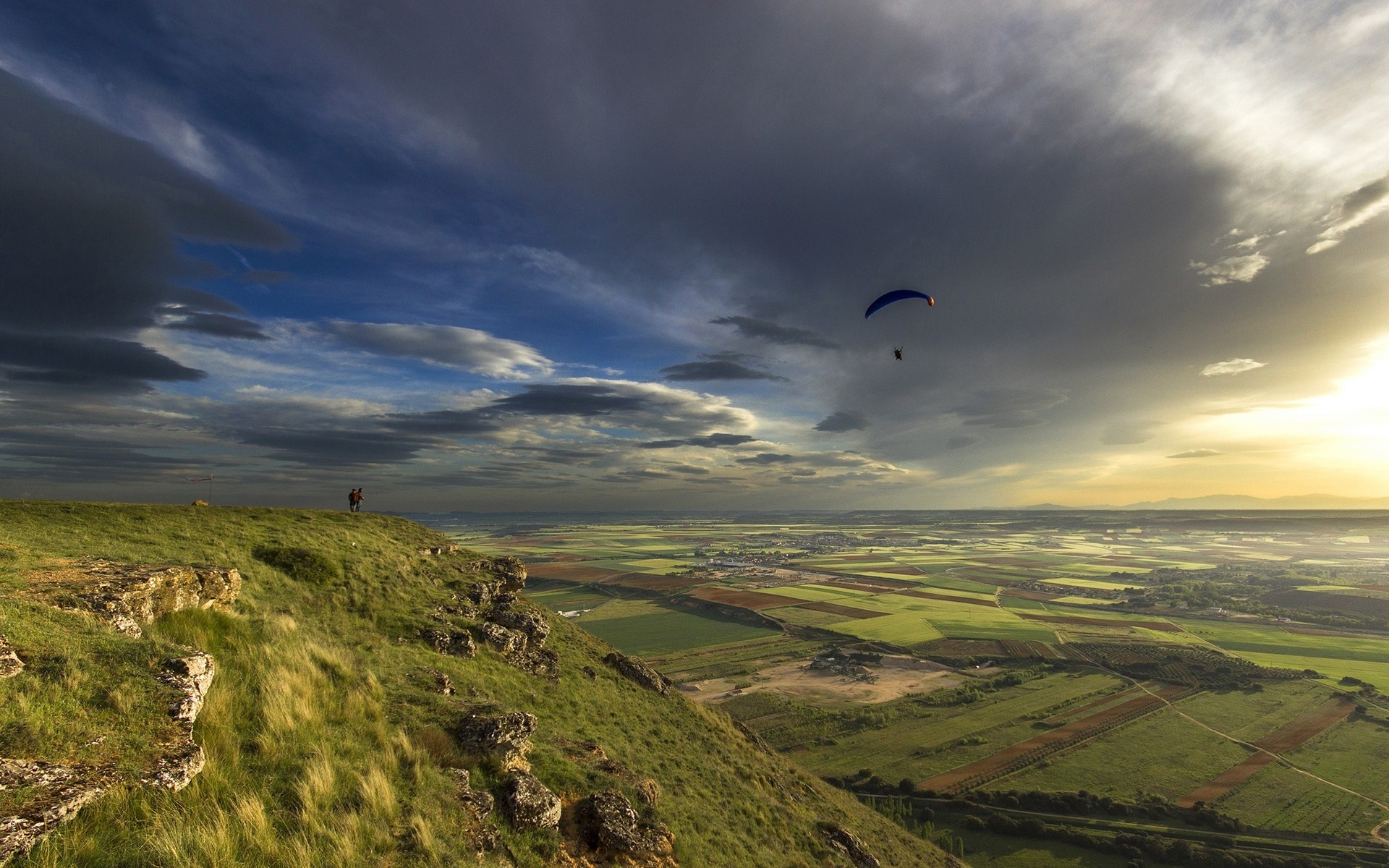 parachute skydiving sky clouds sunlight sunset sunrise flight fly people mountains hills nature landscapes fields grass plants green scenic view