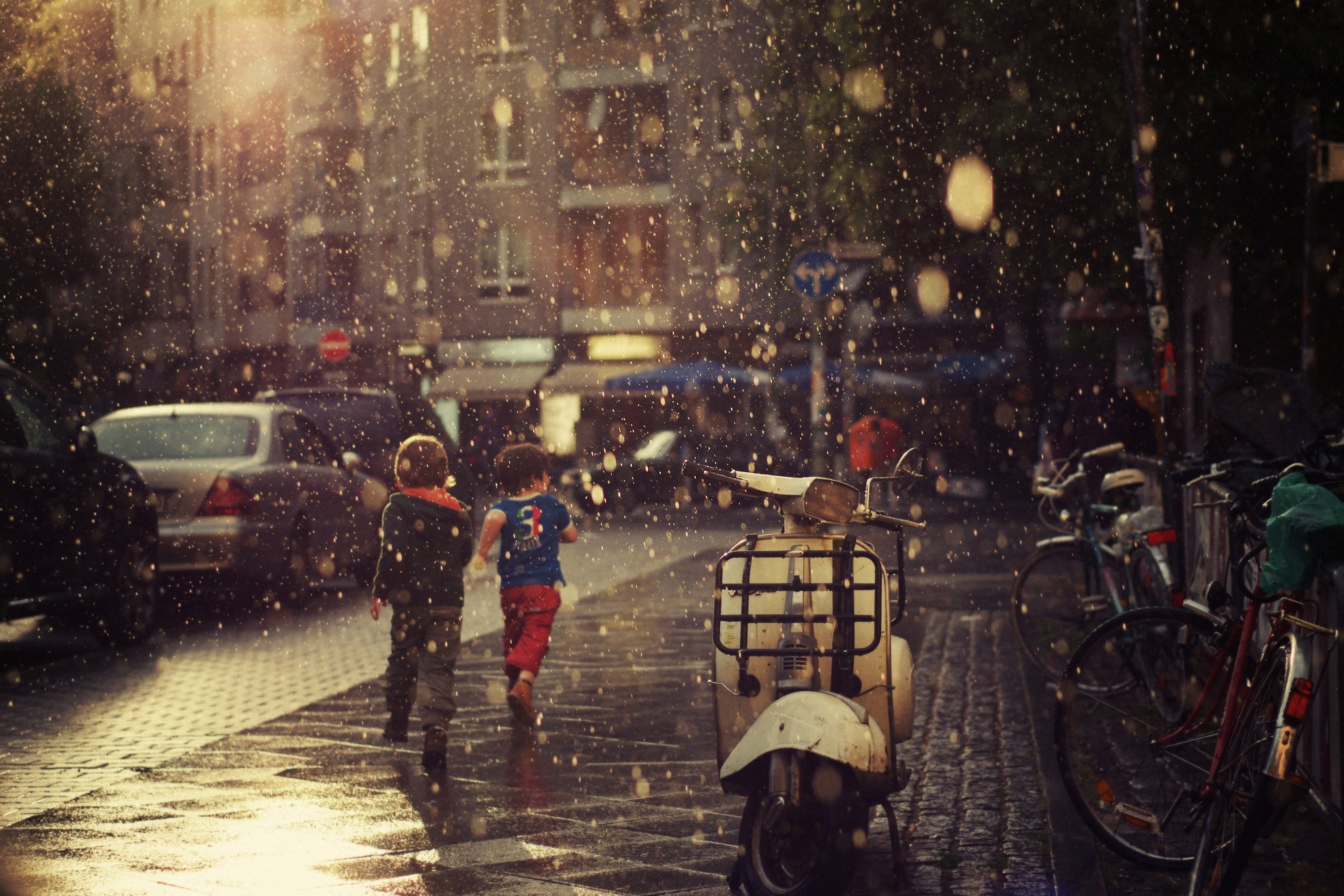 rain rain-drops water-drops drops children people vehicles scooters motorcycles places cities architecture buildings photography roads