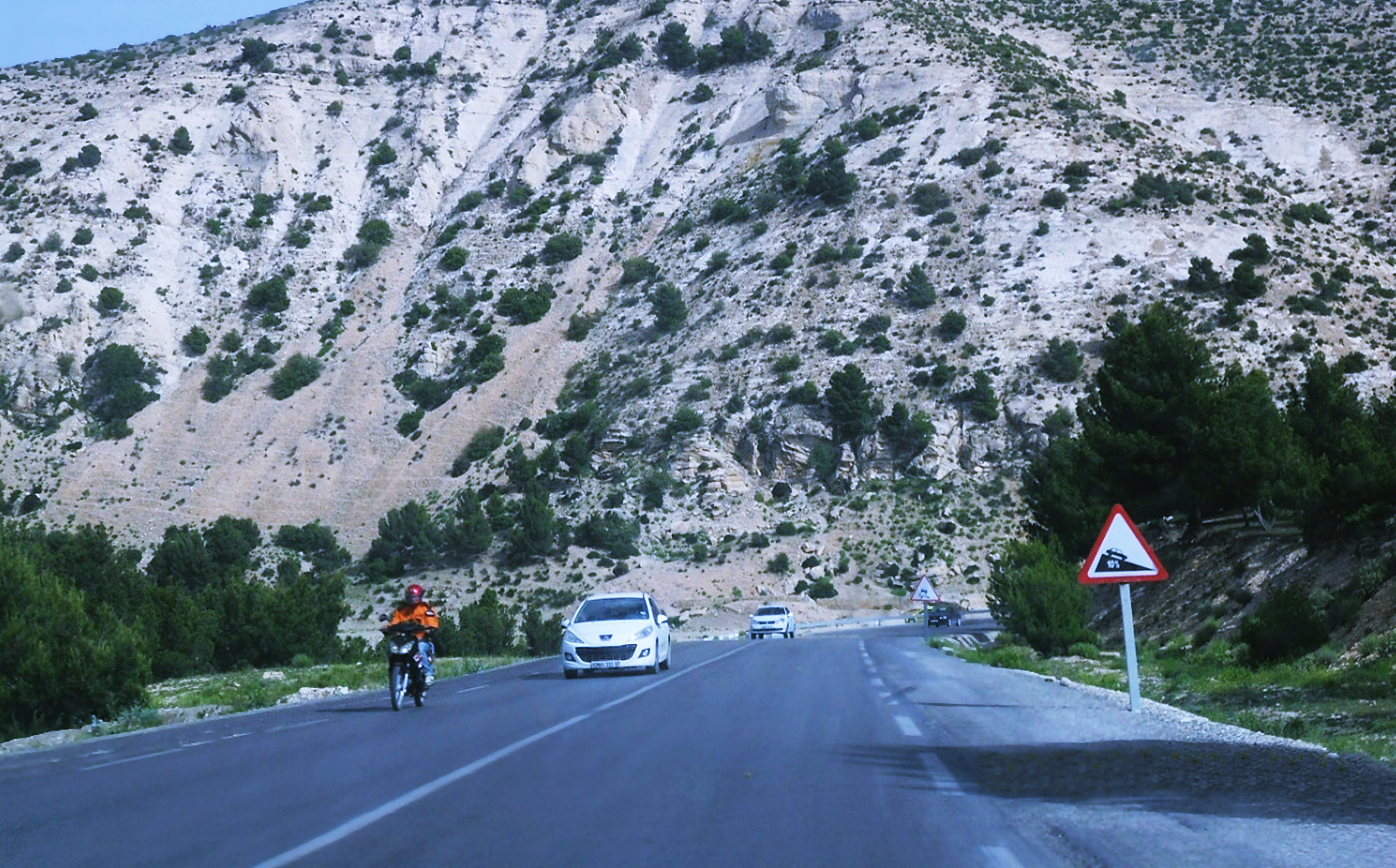 road tebessa mountains trees hills cars motorcycles landscapes nature algeria north africa chaoui amazigh