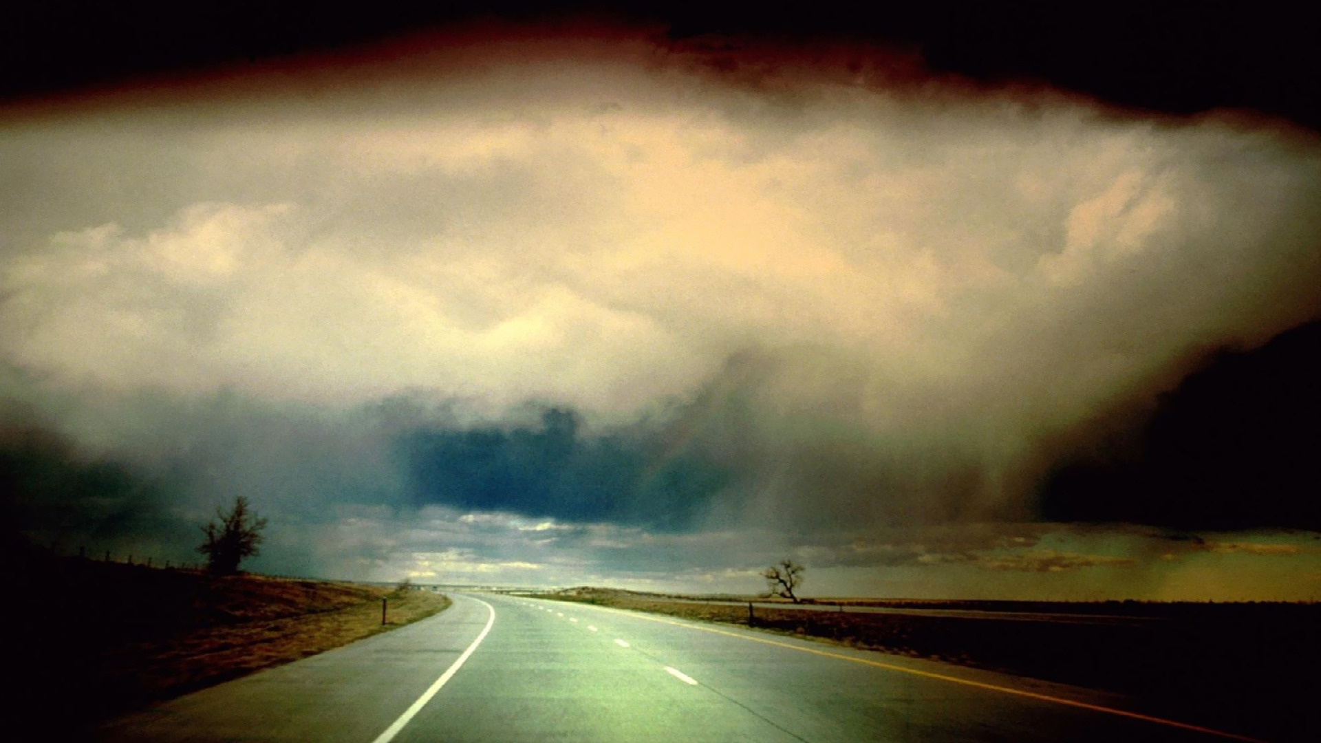 Storm clouds over empty road