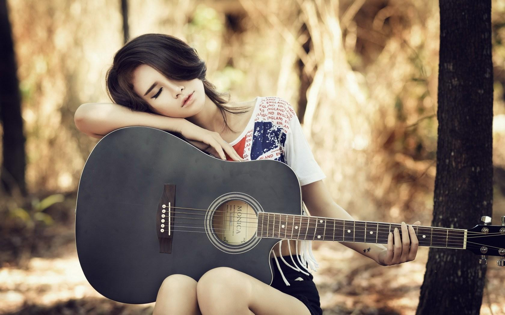 Superb girl with a guitar