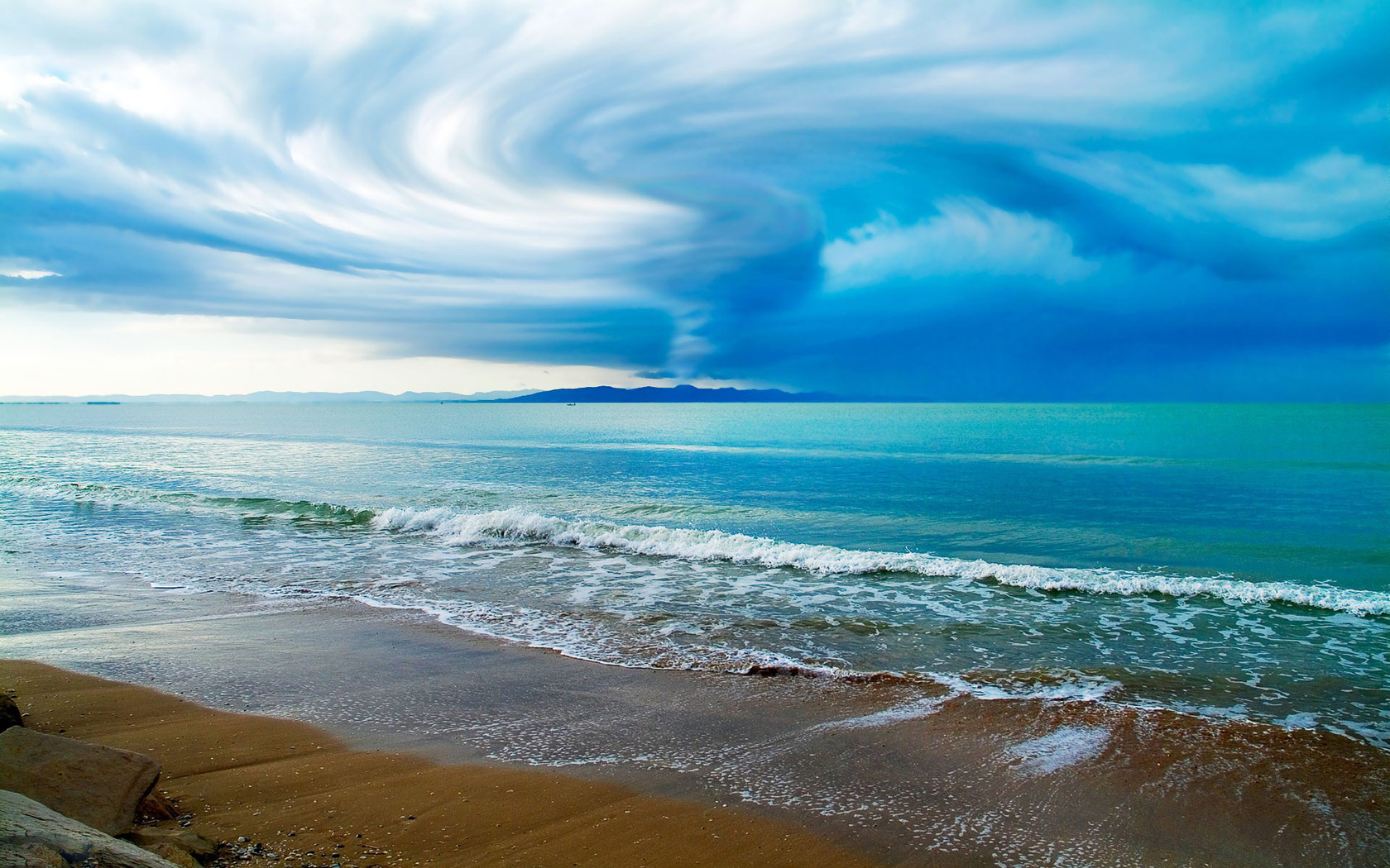 Swirling clouds over ocean
