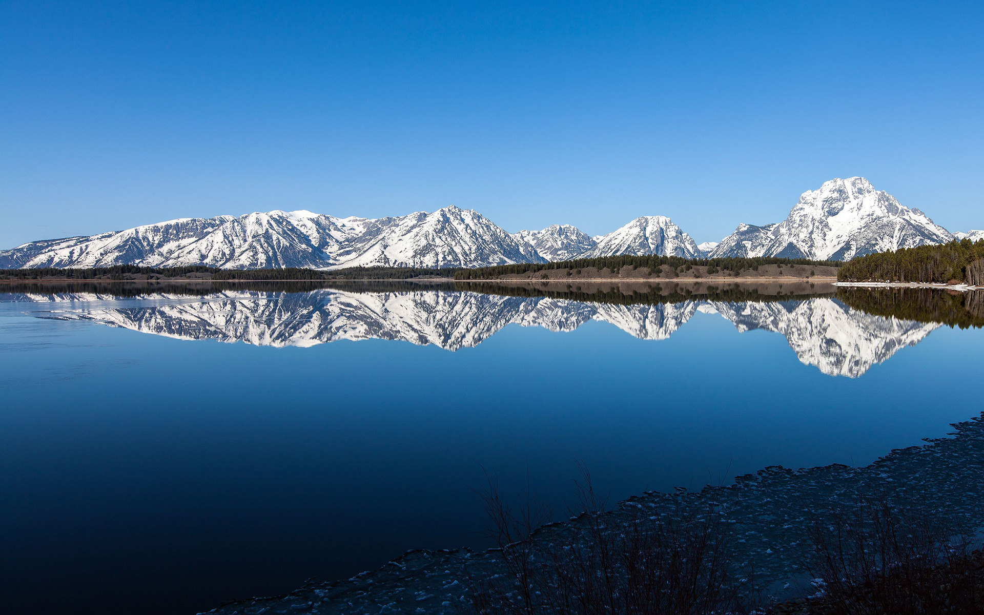 White mountains reflecting in the lake