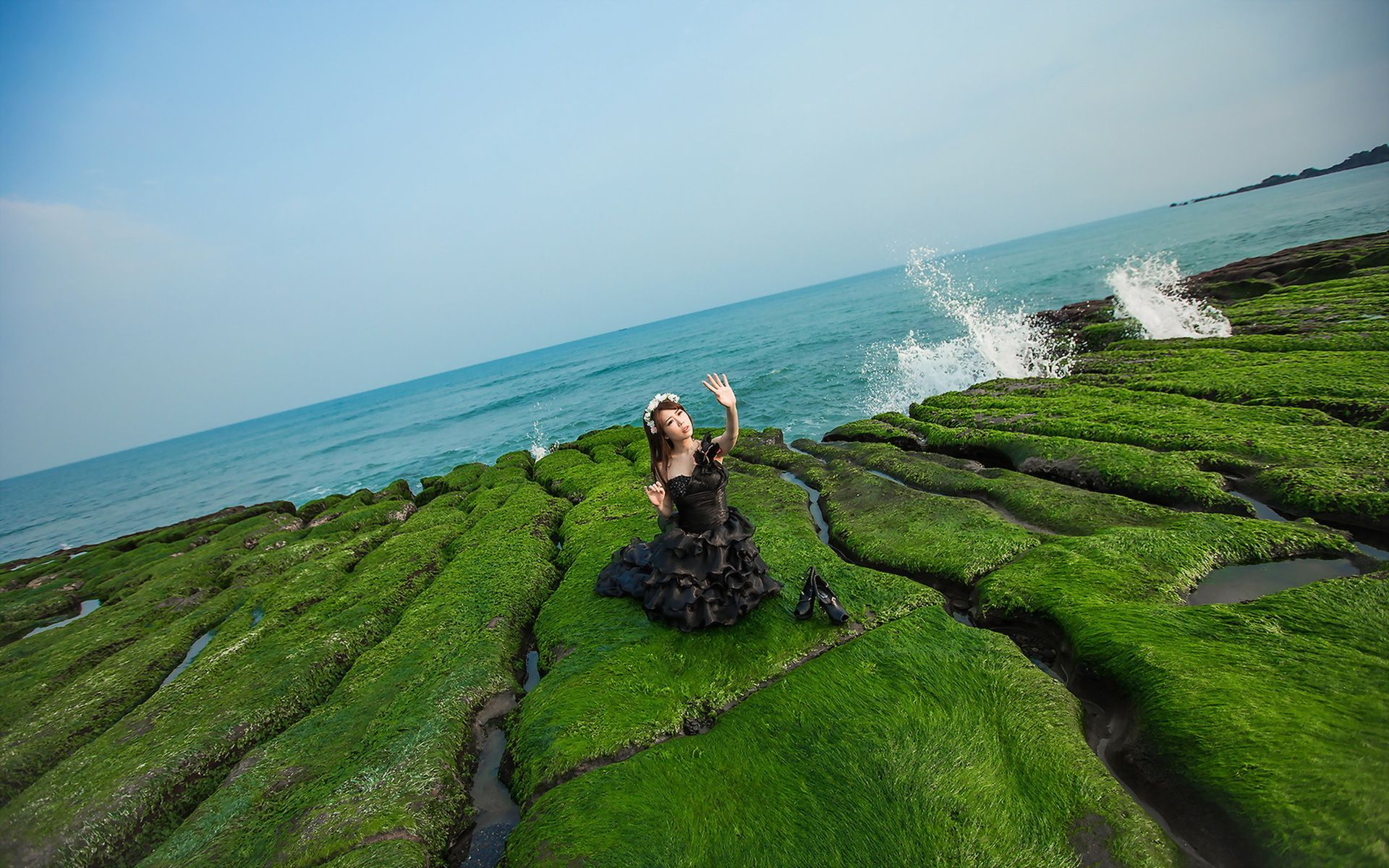 Woman on the mossy rocks