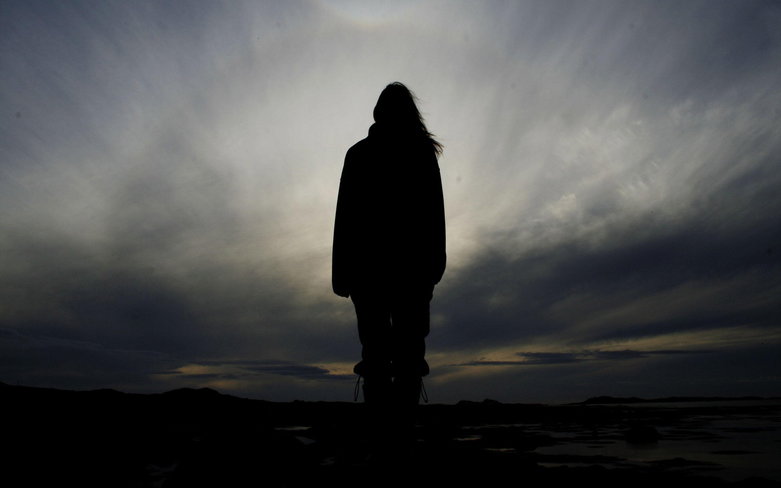 Woman's silhouette under the evening sky