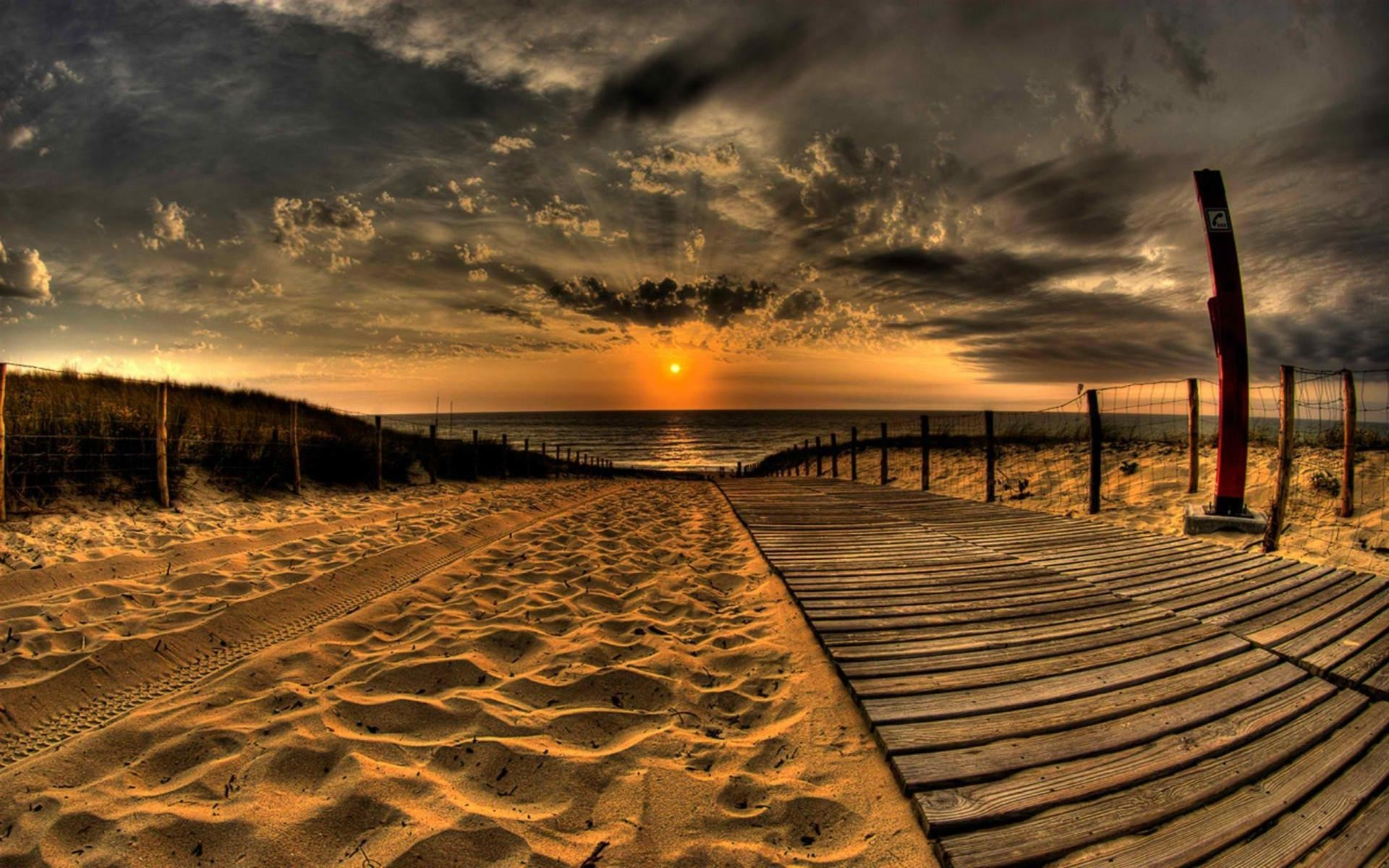 Wooden path in the sand